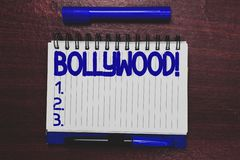 Conceptual hand writing showing Bollywood. Business photo text Indian popular film movies industry Mumbai Cinematography. Open notebook page marker royalty free stock photography