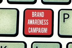 Conceptual hand writing showing Brand Awareness Campaign. Business photo showcasing How aware consumers are with your products. Keyboard key Intention to create stock photography