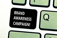 Conceptual hand writing showing Brand Awareness Campaign. Business photo showcasing How aware consumers are with your. Products Keyboard key Intention to create stock photography
