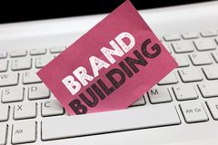 Conceptual hand writing showing Brand Building. Business photo showcasing Generating awareness Establishing and promoting company.  royalty free stock photo