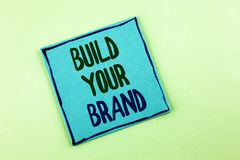 Conceptual hand writing showing Build Your Brand. Business photo showcasing create your own logo slogan Model Advertising E Market. Ing written Sticky Note Paper royalty free stock photos