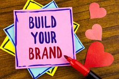 Conceptual hand writing showing Build Your Brand. Business photo text create your own logo slogan Model Advertising E Marketing wr. Itten Sticky note paper stock photo