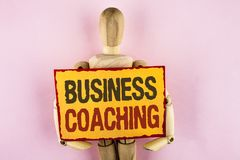 Conceptual hand writing showing Business Coaching. Business photo text consulting expert your field Experience improvement written. Sticky note paper Wooden Royalty Free Stock Photography