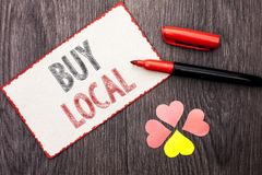 Conceptual hand writing showing Buy Local. Business photo text Buying Purchase Locally Shop Store Market Buylocal Retailers writte. N Cardboard Piece With Marker Royalty Free Stock Photo