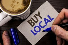 Conceptual hand writing showing Buy Local. Business photo text Buying Purchase Locally Shop Store Market Buylocal Retailers writte. N Man Holding Marker Note Stock Images