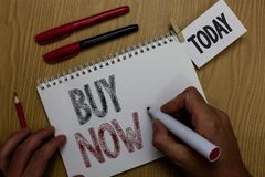 Conceptual hand writing showing Buy Now. Business photo showcasing asking someone to purchase your product Provide good Discount M. An holding marker notebook royalty free stock images