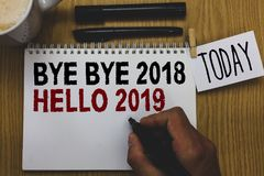 Conceptual hand writing showing Bye Bye 2018 Hello 2019. Business photo text Starting new year Motivational message 2018 is over W royalty free stock photography