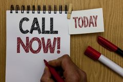 Conceptual hand writing showing Call Now. Business photo text To immediately contact a person using telecom devices with accuracy. Man holding marker notebook stock images