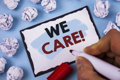 Conceptual hand writing showing We Care Motivational Call. Business photo text Give People Help Attention Support Concept For Info. Conceptual hand writing Stock Photo
