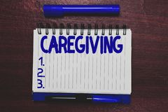 Conceptual hand writing showing Caregiving. Business photo text Act of providing unpaid assistance help aid support. Senior care Open notebook page marker royalty free stock photography