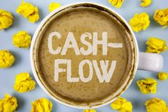 Conceptual hand writing showing Cash-Flow. Business photo text Virtual movement of money by company finance department statistics. Written Coffee in Cup within Stock Photography