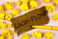 Conceptual hand writing showing Cash-Flow. Business photo text Virtual movement of money by company finance department statistics. Written Tear Cardboard piece stock images