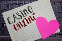 Conceptual hand writing showing Casino Online. Business photo showcasing Computer Poker Game Gamble Royal Bet Lotto High Stakes No. Tebook paper keyboard royalty free stock image