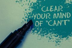 Conceptual hand writing showing Clear Your Mind Of Can t not. Business photo showcasing Have a positive attitude thinking motivati. On Sprinkle blue color on Royalty Free Stock Image