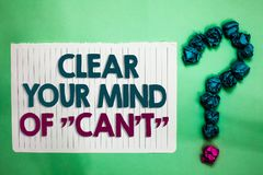 Conceptual hand writing showing Clear Your Mind Of Can t not. Business photo text Have a positive attitude thinking motivation whi. Te notepad with words teal Royalty Free Stock Photography