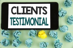 Conceptual hand writing showing Clients Testimonial. Business photo text Customers Personal Experiences Reviews Opinions Feedback. Written Mobile Phone Screen Royalty Free Stock Photo