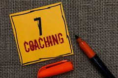 Conceptual hand writing showing 7 Coaching. Business photo showcasing Refers to a number of figures regarding business to be succe. Sful Orange paper Marker stock images