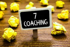 Conceptual hand writing showing 7 Coaching. Business photo showcasing Refers to a number of figures regarding business to be succe. Sful Blackboard crumpled royalty free stock photography