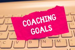 Conceptual hand writing showing Coaching Goals. Business photo text Empowers individuals Encourages them to take responsibility.  stock photography