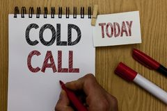Conceptual hand writing showing Cold Call. Business photo text Unsolicited call made by someone trying to sell goods or services M. An holding marker notebook Stock Image