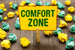 Conceptual hand writing showing Comfort Zone. Business photo text A situation where one feels safe or at ease have Control Clothes. Pin holding yellow note paper stock images