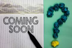 Conceptual hand writing showing Coming Soon. Business photo text something is going to happen in really short time of period Noteb. Ook marker crumpled papers royalty free stock photos