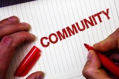 Conceptual hand writing showing Community. Business photo showcasing Neighborhood Association State Affiliation Alliance Unity Gro. Up Man hold holding marker Royalty Free Stock Photos