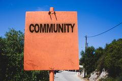 Conceptual hand writing showing Community. Business photo text Neighborhood Association State Affiliation Alliance Unity Group Woo. Den board post ideas blue sky Royalty Free Stock Images