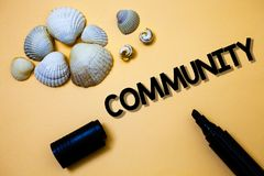 Conceptual hand writing showing Community. Business photo text Neighborhood Association State Affiliation Alliance Unity Group Yel. Low background shadow open Royalty Free Stock Photo