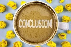 Conceptual hand writing showing Conclusion Motivational Call. Business photo text Ending a story with inspirational quotes written. Coffee in Cup within Paper Royalty Free Stock Photography