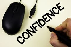 Conceptual hand writing showing Confidence. Business photo showcasing Never ever doubting your worth, inspire and transform yourse. Lf written by Man holding royalty free stock image