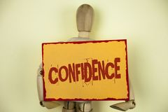 Conceptual hand writing showing Confidence. Business photo text Never ever doubting your worth, inspire and transform yourself wri. Tten Sticky Note paper plain royalty free stock image