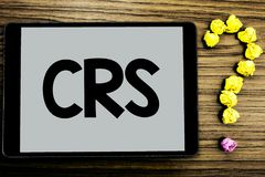 Conceptual hand writing showing Crs. Business photo showcasing Common reporting standard for sharing tax financial information wri. Tten Tablet Screen wooden Stock Photos