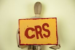 Conceptual hand writing showing Crs. Business photo text Common reporting standard for sharing tax financial information written o. Conceptual hand writing Royalty Free Stock Photography