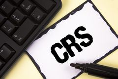Conceptual hand writing showing Crs. Business photo text Common reporting standard for sharing tax financial information written o. Conceptual hand writing Royalty Free Stock Photos