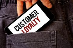 Conceptual hand writing showing Customer Loyalty. Business photo showcasing Client Satisfaction Long-Term relation Confidence Man. Holding cell phone white stock photos