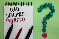 Conceptual hand writing showing Dad You Are My Hero. Business photo showcasing Admiration for your father love feelings compliment. Sticky note with texts touch royalty free stock images