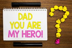 Conceptual hand writing showing Dad You Are My Hero. Business photo showcasing Admiration for your father love feelings compliment. White page with bright color royalty free stock image