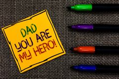 Conceptual hand writing showing Dad You Are My Hero. Business photo text Admiration for your father love feelings compliment Writt. En on black lined yellow royalty free stock photos