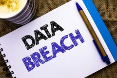 Conceptual hand writing showing Data Breach. Business photo showcasing Stolen Cybercrime Information Hacking Security Malicious Cr. Ack written Notebook Book the Stock Image
