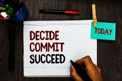 Conceptual hand writing showing Decide Commit Succeed. Business photo text achieving goal comes in three steps Reach your dreams R. Egister pages handwriting stock photography