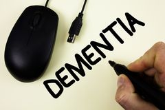 Conceptual hand writing showing Dementia. Business photo showcasing Long term memory loss sign and symptoms made me retire sooner. Written by Man holding Marker Stock Image