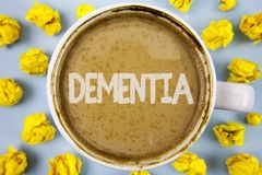 Conceptual hand writing showing Dementia. Business photo text Long term memory loss sign and symptoms made me retire sooner writte. N Coffee in Cup within Paper Stock Image
