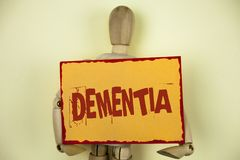 Conceptual hand writing showing Dementia. Business photo text Long term memory loss sign and symptoms made me retire sooner writte. N Sticky Note paper plain Stock Images