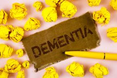 Conceptual hand writing showing Dementia. Business photo text Long term memory loss sign and symptoms made me retire sooner writte. N Tear Cardboard piece plain Stock Photo