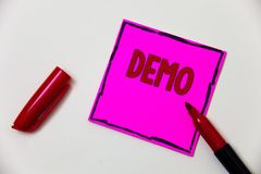 Conceptual hand writing showing Demo. Business photo showcasing Trial Beta Version Free Test Sample Preview of something Prototype. Pink note open marker Stock Images