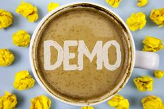Conceptual hand writing showing Demo. Business photo text Demonstration of products by software companies are displayed annually w. Ritten Coffee in Cup within Royalty Free Stock Photo