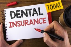 Conceptual hand writing showing Dental Insurance. Business photo text Dentist healthcare provision coverage plans claims benefit w. Ritten by Man Notepad holding Royalty Free Stock Photo