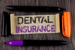 Conceptual hand writing showing Dental Insurance. Business photo text Dentist healthcare provision coverage plans claims benefit w. Ritten Cardboard Paper the Royalty Free Stock Photo