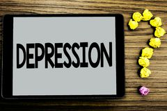 Conceptual hand writing showing Depression. Business photo showcasing Work stress with sleepless nights having anxiety disorder wr. Itten Tablet Screen wooden royalty free stock images